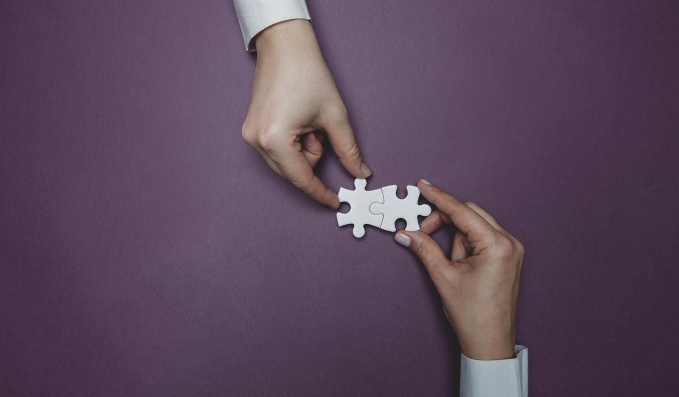 Concept of connecting with your prospective customers - businessman and a customer putting puzzle pieces together.