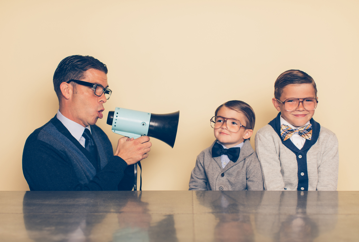 Male salesperson using a megaphone and salesy behaviors to reach to prospective customers.